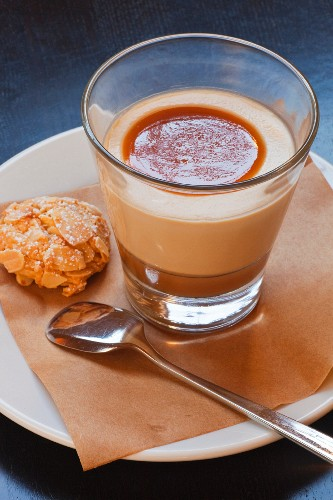 Butterscotch pudding with an almond biscuit