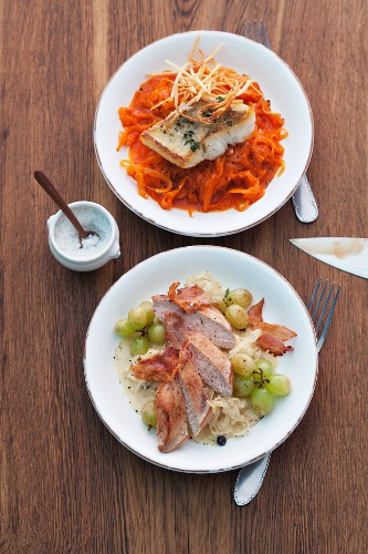 Red sauerkraut with fried fish and sauerkraut with pheasant breast, bacon and grapes