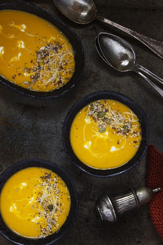 Sweet potato and carrot soup topped with seeds