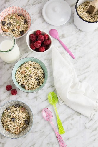 Muesli with oatmeal, raspberries and milk