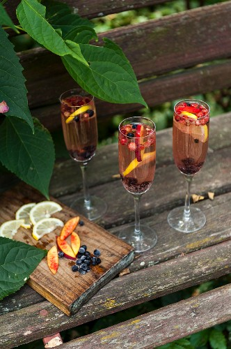 Three glasses with cold fruit drinks for summer