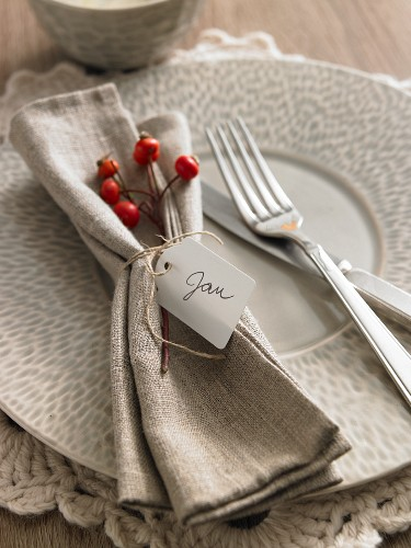 An Autumnal place setting with a serviette and a name tag