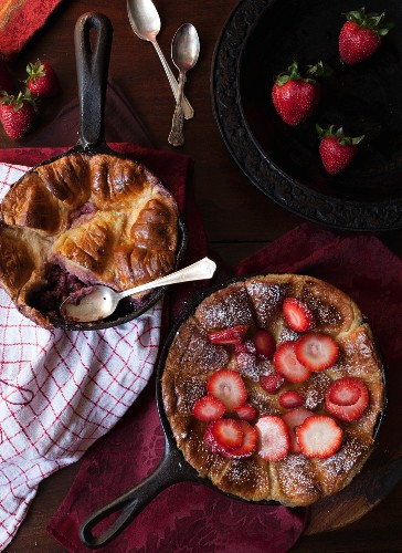 Skillet Baked Bread Pudding with Strawberries and Icing Sugar