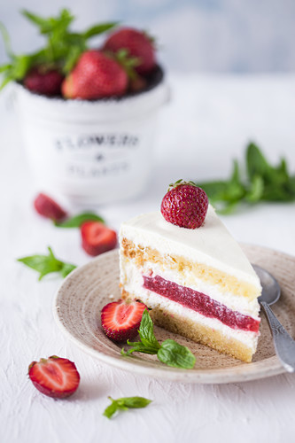 Slice of a vanilla and strawberry cake.