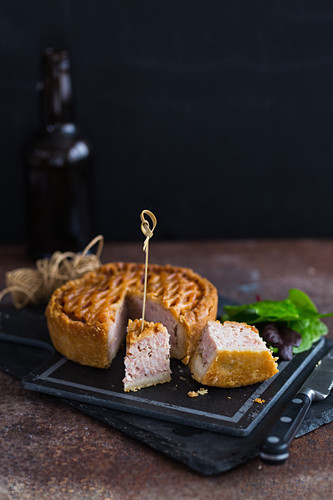 A lattice pork pie with two pieces cut out