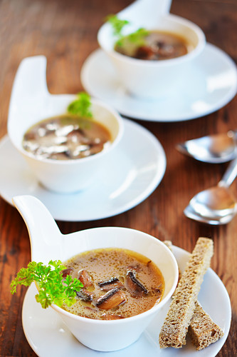 Mushroom soup with toast and fresh parsley