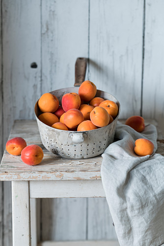 Apricots in a vintage colander