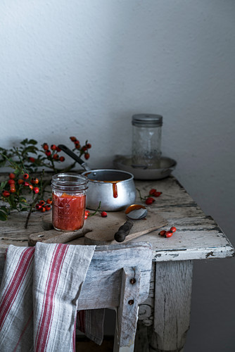 Rose hip jam on a wooden table