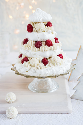 A pavlova with coconut pralines and raspberries for Christmas