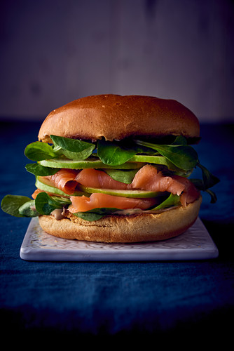 A smoked salmon, apple and lambs lettuce burger