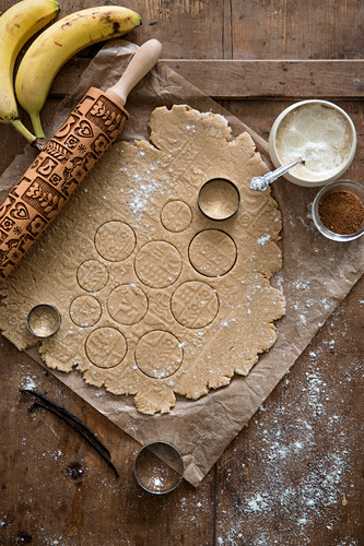 Vegan biscuit dough with a patterned rolling pin