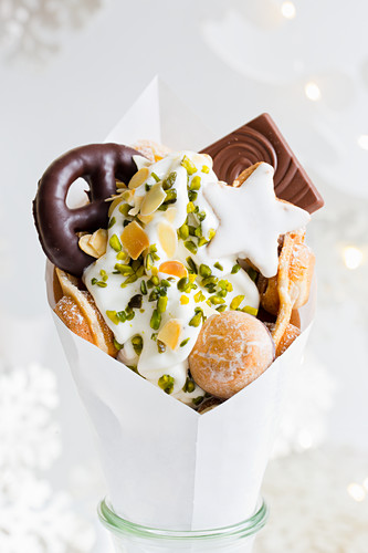 A bubble waffle with frozen yoghurt and cinnamon stars for Christmas