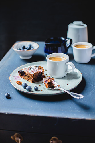 A slice of blueberry cake and coffee