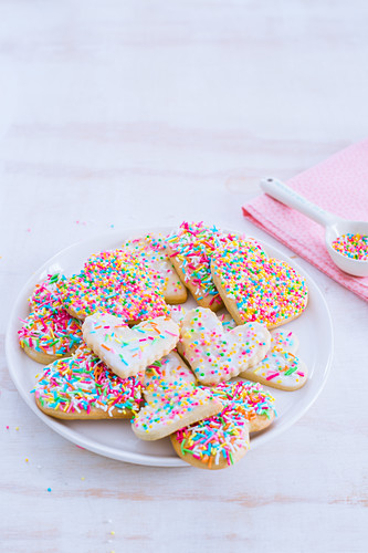 Heart shaped cookies with colorful sprinkles