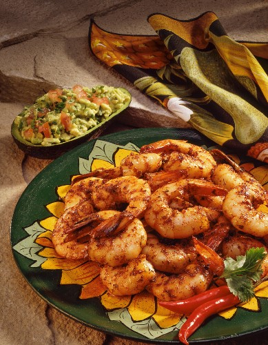 Spicy prawns with guacamole served in an avocado shell