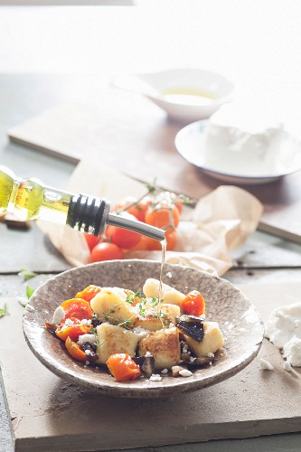 Fried gnocchi with aubergines and tomatoes