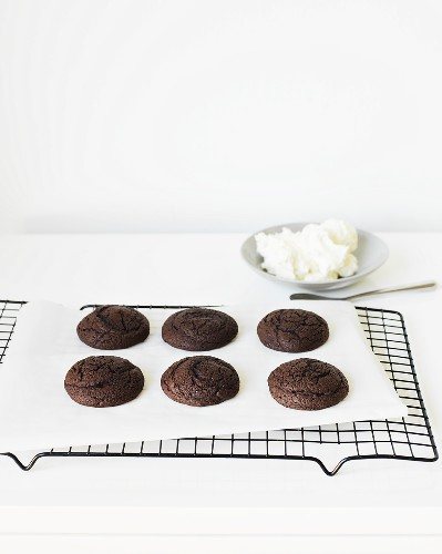 Chocolate Whoopie Pies (halves) on a cooling rack