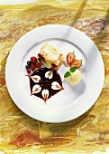Strudel lasagne with berries om red sauce & scoop of ice cream