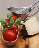 Fresh tomatoes, basil and piece of cheese; sauce-boat