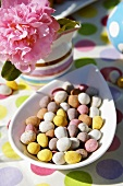 Chocolate almonds with pastel-coloured sugar coating