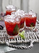 Pomegranate cocktail with mint, gin and crushed ice