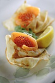 Crêpes with smoked salmon and salmon caviar