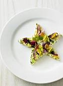 Salad star with edible flowers on plate