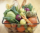 Vegetables, fruit and bread in basket