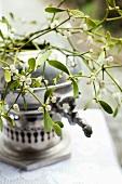 Mistletoe sprigs in an old samowar