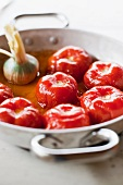 Whole, braised tomatoes with garlic