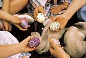 Children Holding Colorful Easter Eggs