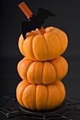 Three Mini Pumpkins Stacked as Halloween Decoration