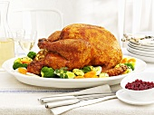 Roast turkey with vegetables and cranberries