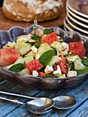 A summer salad with melon, mint, feta and pomegranate