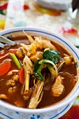 Tom Yam Gai (Thai hot and sour soup with vegetables and chicken)