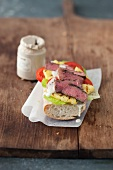 Rump steak, pineapple and lime mayonnaise on a baguette