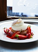 A profiterole with cream and fresh strawberries (choux chantilly)