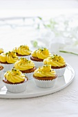 Cupcakes decorated with lemon cream and pistachio nuts