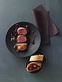 Saddle of venison wrapped in potato with mulled wine and onion chutney and red cabbage and nut strudel