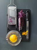 Red cabbage being cut and orange zest being grated