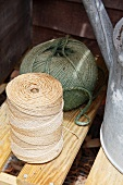 A watering can and rolls of twine