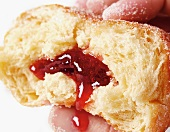 Doughnut filled with red currant jam