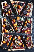 Hand made pizza with red onion, garlic, pumpkin, spinach, mushroom and black pudding