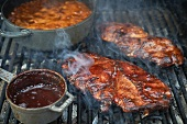 Barbecue Pork Steaks and Baked Beans on a Grill