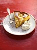 A slice of apple cake with cream