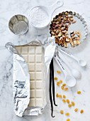 White chocolate, vanilla pods, raisins, pistachios and icing sugar