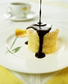 Chocolate sauce running over lemon souffle