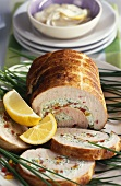 Turkey roll with pepper & cream cheese stuffing, cut into
