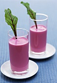 Beetroot yoghurt drink garnished with beetroot leaves