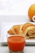 Croissant and carrot juice
